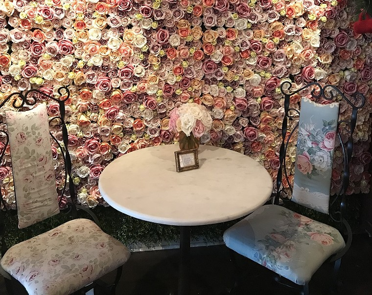 Ann's Rose Wall is a cherished staple of the Las Olas all-in-one coffee, wine, and flower shop. - AYURELLA HORN-MULLER