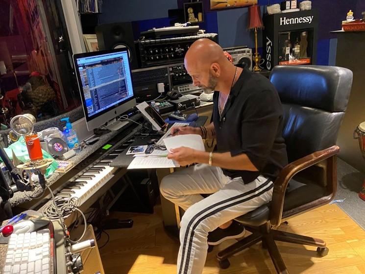 Marlow Rosado is hard at work in his Miami Lakes recording studio. - PHOTO COURTESY OF DEBORAH RAMIREZ